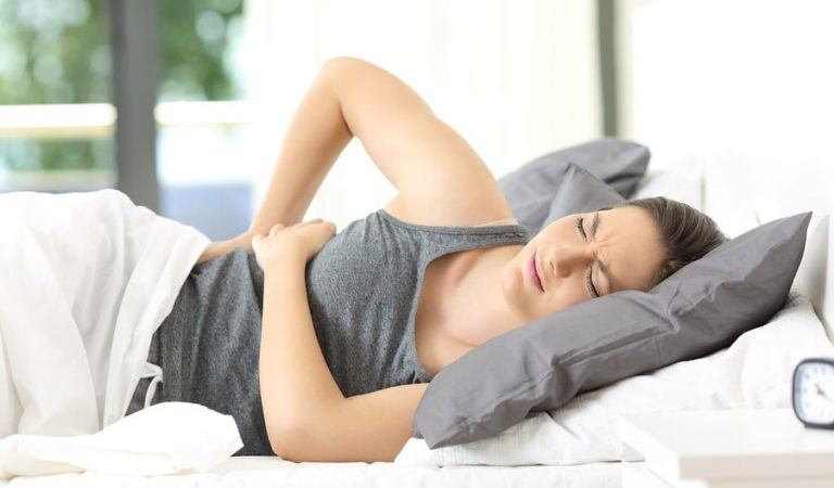 What should I do if my lower back hurts after sleep?